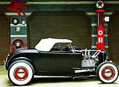 Old School '32 Roadster with a hopped up flathead ....