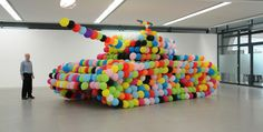 Featured Image for Hundreds of balloons combine to make a colourful, child-friendly tank