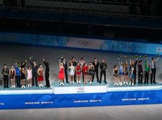 DAY 3:  (L-R) Silver medalists team Canada, gold medalists team Russia and bronze medalists team USA during the flower ceremony for the Team Figure Skating Overall