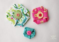 "These are cute, but I would sew the buttons on, and ... I wonder if they could be made with 5 ""petals"" instead of 4 ... I think an odd number would make a prettier project :)"