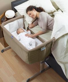 Chicco Next to Me Bedside Crib  Secures to the side of the bed with the use of 2 fasteners. Mattress is included