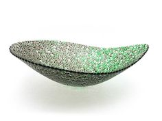 Nido 11 Concord and Meadow Green Bowl by Joseph Enszo. Taking inspiration from macro and microscopic designs, Joseph Enszo utilizes traditional Italian techniques, redesigned to emphasize the natural properties of glass under various physical forces. Enszo's aesthetic is a unique intersection of three components: Italian decorativeness, Eastern simplicity, and a reference to natural science. The process begins with thousands of individual handmade murrine, which are laid out and fused in...