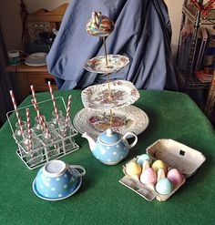 Cake stand;coloured eggs; small drinking bottles and straws