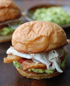 Crispy Club Sandwiches with Avocado: Recipe for 2 sandwiches-4 strips of thick-cut bacon, 2 hamburger buns split, olive oil,1/2 ripe avocado, 2 oz. shaved turkey breast,  1 garden-ripe tomato thick slices, salt & freshly ground pepper