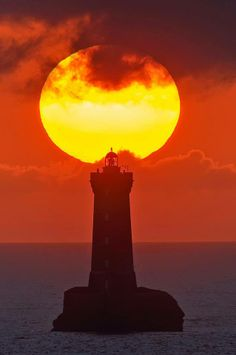 """""""Le Four"""" lighthouse playing cup-and-ball with the sun. June 18, 2012 Argenton-en-landunvez, Brittany, France"""