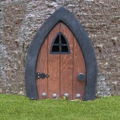 I think this door is adorable!  It's a 9 inch gnome, fairy or elf door, custom made and available on Etsy.  $23.59