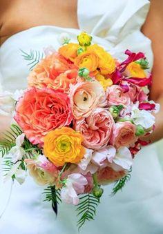 Bloom Up North, Michigan, bridal bouquet of orange roses, gold ranunculus, peach garden roses, gloriosa lilies, sweet peas