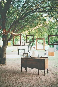 suspended frames over the cake table