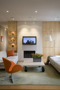 What material is the fireplace surround and above. Where can it be purchased? - Houzz