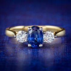 SAPPHIRE DIAMOND TRILOGY RING 18CT GOLD 0.80CT SAPPHIRE 0.40CT OF DIAMOND cover Sapphire Rings, Sapphire Diamond, Blue Sapphire, Enagement Rings, All Gems, Diamond Clarity, Gold Bands, Antique Jewelry, Diamond Cuts