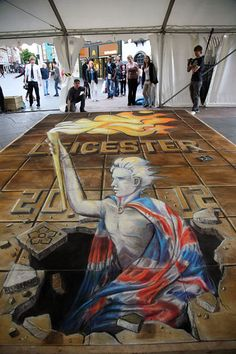 The Olympic Torch in Leicester. - Julian Beever