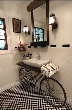 Looking at this charming bathroom with a creative twist, a bicycle sink. Would you ever use a bike and transform it into a bicycle sink in your bathroom? I think the black & white tile floor and b Bicycle Sink, Old Bicycle, Bicycle Decor, Bicycle Basket, Bicycle Wheel, Tandem Bicycle, Cruiser Bicycle, Style At Home, Cali Style