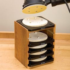 The Rockler Sandpaper disc station is a way to keep your wood shop organized and makes attaching a new sanding disc to your sander easy. Workshop Storage, Workshop Organization, Tool Storage, Diy Shops, Garage Tools, Shop Layout, Homemade Tools, Wood Tools, Wood Projects