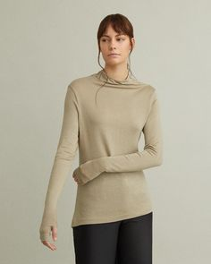 Delicate knit top with high neckline and thumbholes. High draped neckline Extra long sleeves Thumb holes Viscose, Elastane Model is 178 ft 10 in and is wearing a size S Jil Sander, Designing Women, Fashion Brands, Pullover, Knitting, Apothecary, Long Sleeve, Sleeves, Model