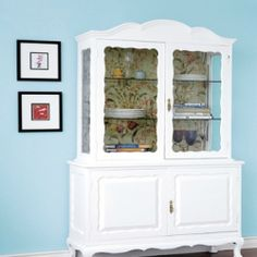 Here's how to repaint a vintage cabinet glossy white and add floral fabric backing to retain its antique style while making it look new.