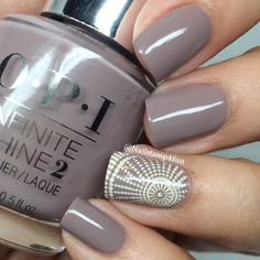Nailstampforfun's latest solid mani, is suddenly interrupted by a burst of circles and dots on one nail for accent. Get this gorgeous grey from OPI #InfiniteShine. You'll definitely go ga-ga over it's mirror like finish.