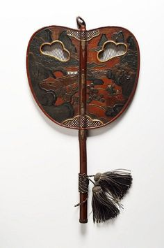 A LACQUERED WOOD UCHIWA FAN-Japan, Edo period (early 19th century). Height 43.5 cm. Wood decorated with lacquer, raden inlays and partial gilding.