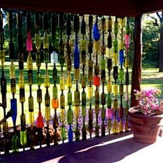 Glass is Life ... Upcycle your old wine bottles into a colorful garden light catcher.