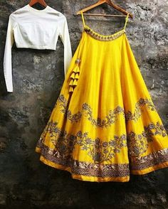 Featuring a yellow lehenga with white plain choli in cotton silk. Lehenga is adorned with gold dori work and sequins work. It comes along with beige net embroidered butti work dupatta and heavy laces cornered. Indian Lehenga, Indian Gowns, Indian Attire, Indian Ethnic Wear, Indian Outfits, Indian Clothes, Indian Wedding Outfits, Bridal Outfits, Lehenga Blouse
