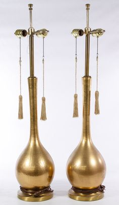 Lot 697: Mid-Century Modern Style Brass Electric Table Lamps by Phil-Mar; Pair of lamps with two light sockets each and a bulbous gold painted brass base