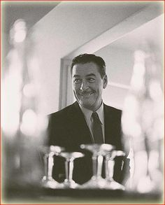 Errol Flynn looking like he has a great story to tell over a cocktail.