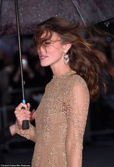 10/8/14.   Hair raising: London's wind and rain left Keira Knightley battling to keep her hair in place as she walked the red carpet at the Imitation Game premiere at the Odeon in Leicester Square on Wednesday