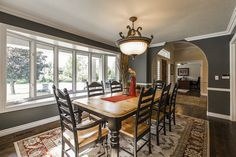This modern dining room uses touches of the dark color in its furniture and decorations.
