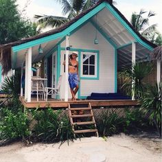 cute turquoise and white bungalow