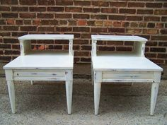 I own 2 of these tables, almost exactly like this picture. I repainted them white, but contemplating a color.....      thoughts :) $15.00 for the pair!