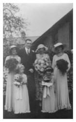 Group Wedding Photograph 1935.. fashions in clothes had become softer in the mid 1930s creating a major contrast to the angular boyish lines of a decade earlier. The bride's dress is unusual in that it is patterned.
