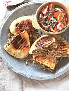 So much Middle Eastern cuisine is interwoven and reinterpreted from country to country, but Lebanon gets the credit for arayes kafta, a fresh lamb-stuffed sandwich. Great party food to pass round or let your guests assemble at the table.