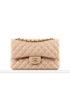 Classics - Classic flap bag  in quilted lambskin.  Also available in silver metal