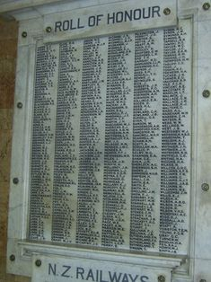 This roll of honour, in the office entrance to Wellington's railway station, lists 450 members of the New Zealand Railways Department who lost their lives during the First World War. (SeeRailways Department Roll of Honourfor a transcript of the names with links to their records on the Cenotaph database.) As many as 5000 of the department's permanent staff enlisted during the war, out of a 1914 workforce of 14,000, and many casual workers also served.The roll was unveiled by Prime Minister…