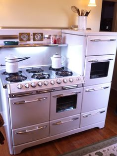 Vintage kitchen stove. 1951 Aristocrat by Okeefe and Merritt: three ovens, warming draw, separate broiler, and six burners!