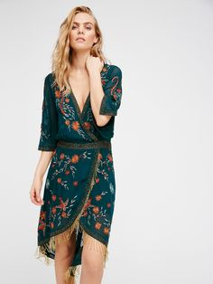 Midnight City Midi Dress | With beautiful embroidery detailing that is embellished with amazing bead work this high low midi dress features a surplice neckline with a hidden snap closure. Sheer three-quarter length sleeves with statement bead fringe trim. Lined.