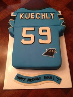 Carolina Panthers Luke Kuechly Cake. Chocolate cake filled with chocolate ganache, frosted with vanilla buttercrea and covered in MM Fondanr.