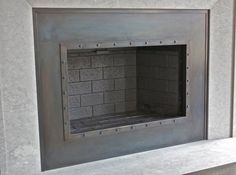Steel Fireplace Surround   Hand made custom fireplace. Ironhaus.com