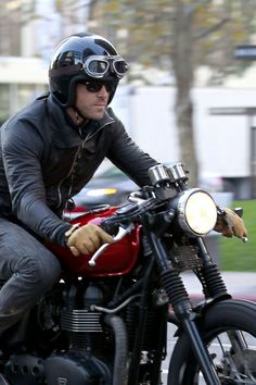 **EXCLUSIVE** Ryan Reynolds is seen riding his Triumph motorcycle as he leaves the set of his new movie