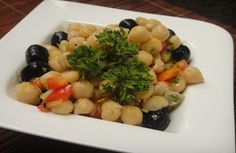 Chickpea and Red Capsicum Salad: Boiled chickpeas, chopped capsicum and olives tossed in tangy orange juice dressing.