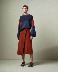 Lightweight yet warm, traditionally spun lambswool. Dropped shoulders. Kimono sleeves. Ribbed neckline, cuffs and hem.