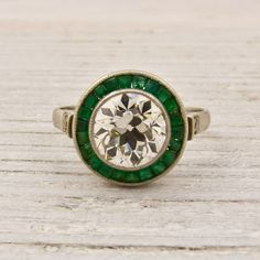 diamond & emerald engagement ring