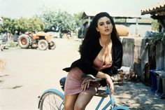 Monica Bellucci on a bike