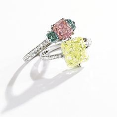 PLATINUM, FANCY INTENSE YELLOW-GREEN DIAMOND AND DIAMOND RING, JAR, PARIS Set with a rectangular modified brilliant-cut Fancy Intense Yellow-Green diamond weighing 3.93 carats, the mounting set with numerous single-cut diamonds weighing approximately .60 carat, size 3¼, signed JAR Paris, with French assay and workshop marks.