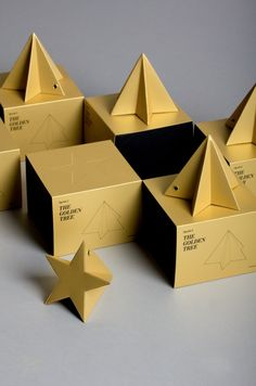 Christmas gift. A paper golden star converted to a paper golden tree.- designed by LO SIENTO