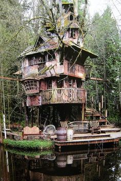 Pirate ship home. How cool would it be to have something like this on your property hidden in a patch of woods, down a stream and hunting for it.. Yea.. my imagination kinda goes wild thinking about stuff like that.. LOVE