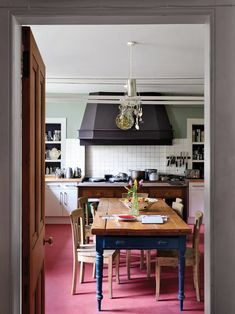 A custom, matte black fume hood brings a unique flair to this kitchen.