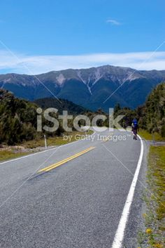 Tramper walks on road in Nelson Lakes National Park, NZ Royalty Free Stock Photo