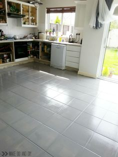 As crazy as it sounds you can paint a ceramic-tile floor like this ...