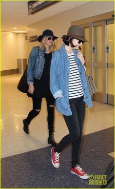 Dakota Johnson Catches Up With Mom Melanie Griffith Following LAX Landing