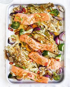 We all love a good traybake, and this salmon traybake with soy and sesame dressing definitely ticks all of the boxes for a speedy weeknight dinner dish. Fish Dishes, Seafood Dishes, Seafood Recipes, Sesame Dressing Recipe, Tray Bake Recipes, Delicious Magazine, Roasted Salmon, Salmon Fillets, Vegetarian Recipes Easy